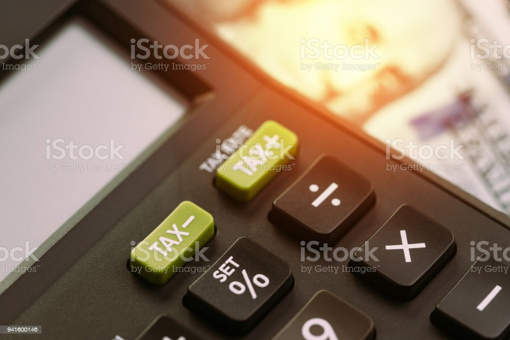 tax cuts or reduce concept selective focus on tax minus buttons on