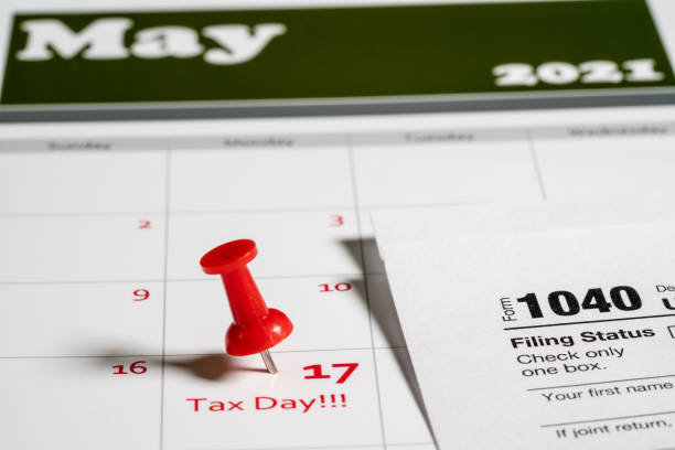 Tax Day concept for May 17 2021 using calendar and note stock photo