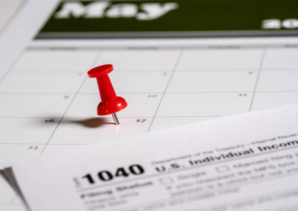 Tax Day concept for May 17 2021 using calendar and push pin stock photo
