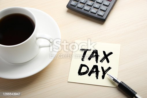 Tax Day concept on the sticky note paper.