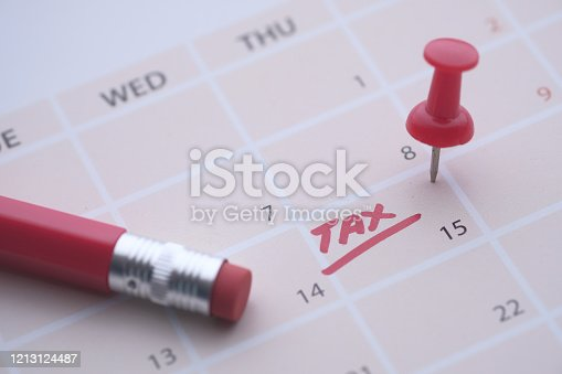 Tax day concept. The USA tax due date marked on the calendar.