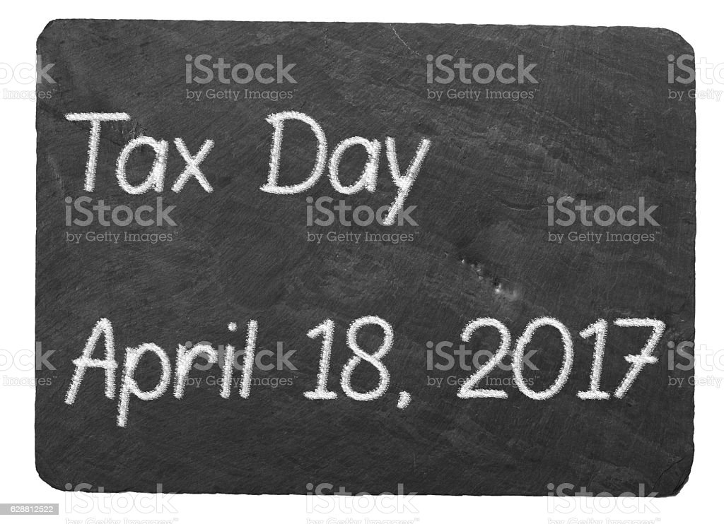 Tax Day concept using chalk on slate blackboard stock photo