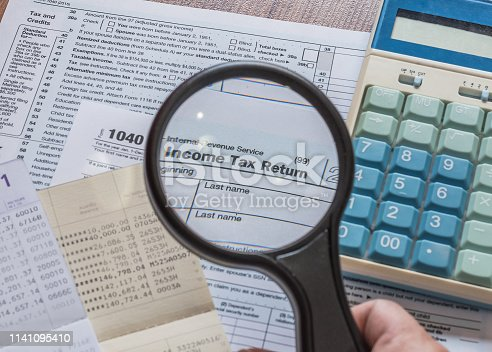 Tax day concept with tax paying preparation and USA    internal revenue service form