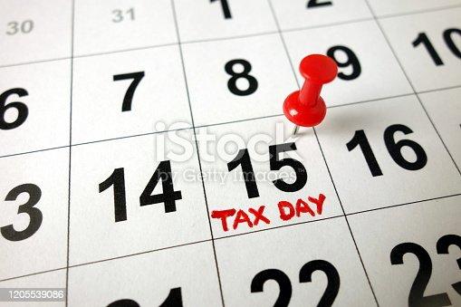 1170746979 istock photo Tax day marked on calendar 1205539086