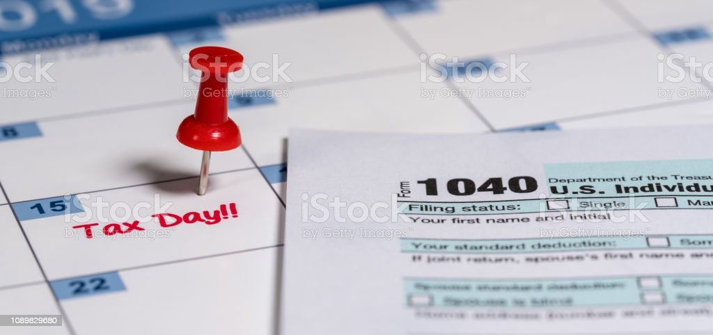 Tax Day reminder for April 15 on calendar stock photo