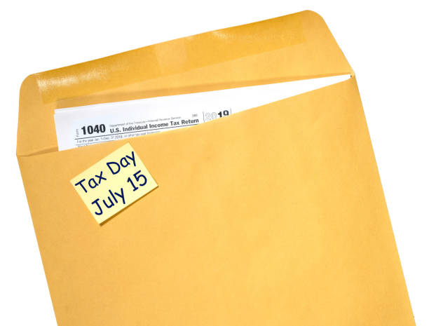 Tax Day reminder for July 15 due to Coronavirus delay on envelope stock photo