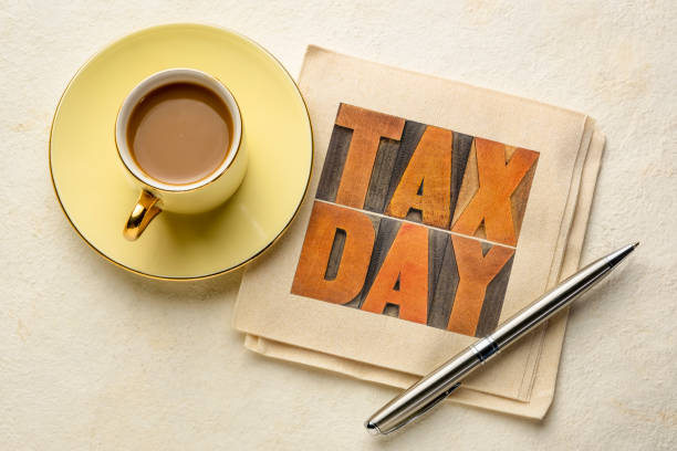 tax day word concept in vintage wood type stock photo