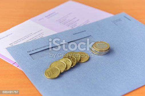 istock Tax declaration with envelope and Euro coins 535491757
