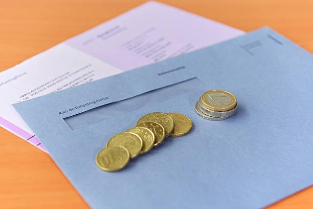 tax declaration with envelope and euro coins - netherlands map stockfoto's en -beelden