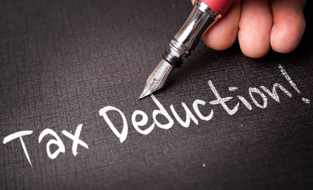 Tax Deduction Tax Deduction writing economic reform stock pictures, royalty-free photos & images