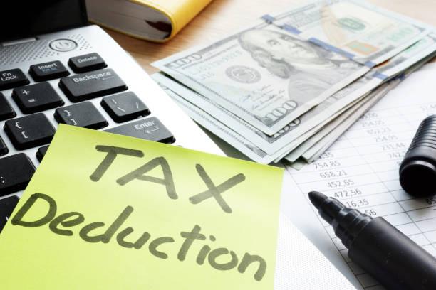Tax deduction written on a memo stick. stock photo