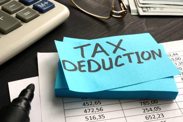 tax deduction written on a piece of paper. - tassa foto e immagini stock