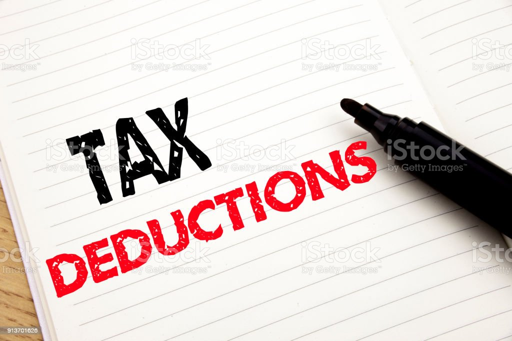 Tax Deductions. Business concept for Finance Incoming Tax Money Deduction written on notebook with copy space on book background with marker pen stock photo