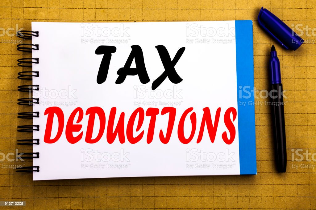 Tax Deductions. Business concept for Finance Incoming Tax Money Deduction Written on notepad note paper background with space office view with pencil marker stock photo