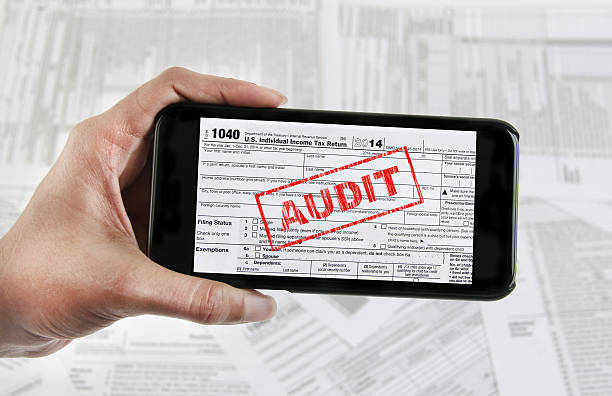 Tax e-file with mobile device stock photo