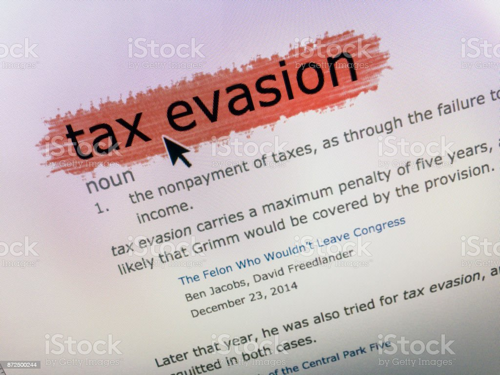 'Tax Evasion' definition dictionary with mouse arrow on computer screen stock photo