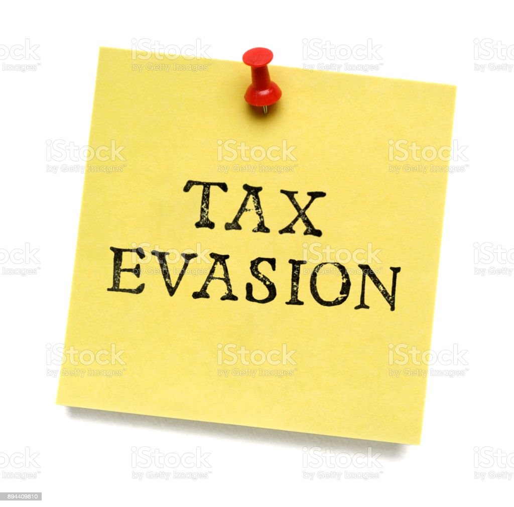 Tax Evasion post-it note stock photo