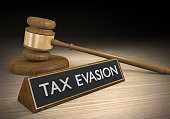istock Tax evasion through illegal schemes and breaking laws, 3D rendering 519899154