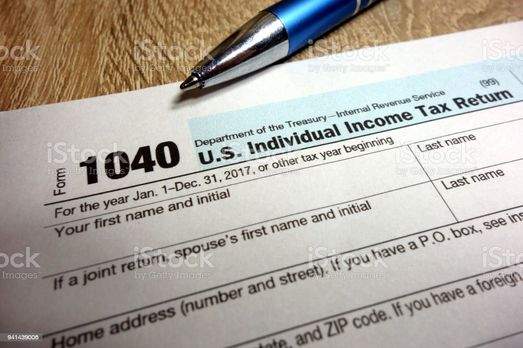 US tax form 1040 and pen stock photo