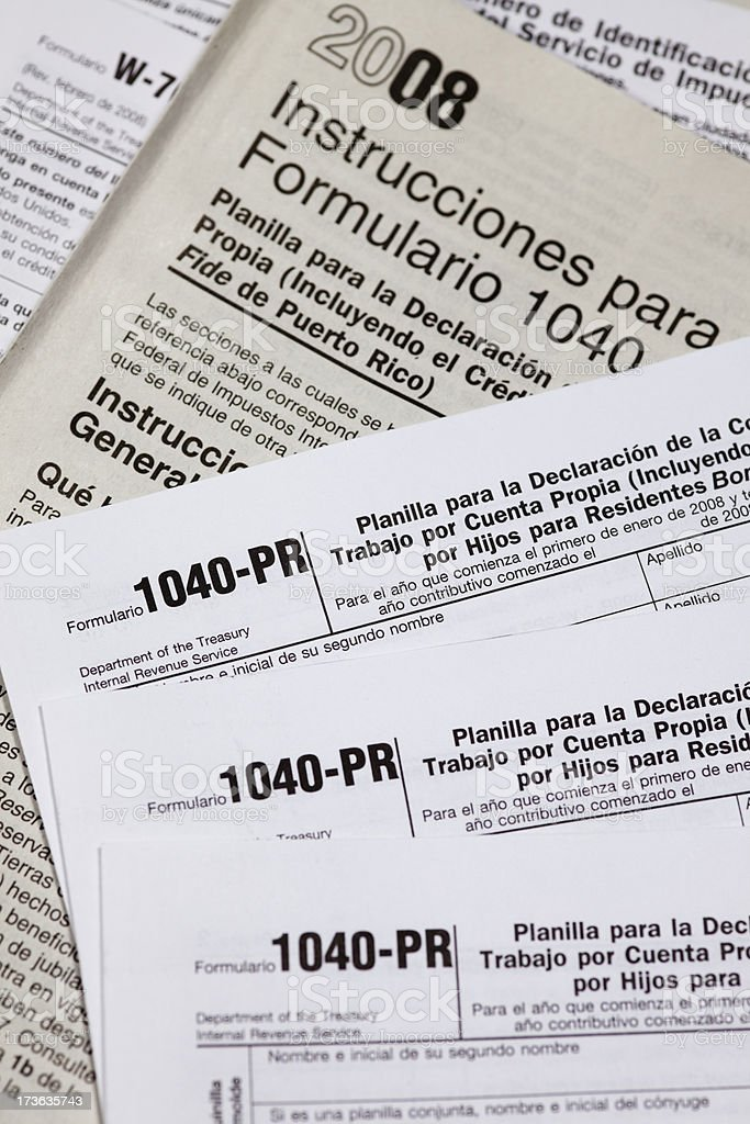 tax-form-1040-in-spanish-for-the-irs-picture-id173635743  Tax Form In Spanish Example on free clip art, self employment, where find income, instruction booklet, line 6d, computation worksheet, schedule itemized deductions, how read, second page, completed sample,