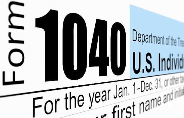 Tax Form 1040 A close-up of the IRS 1040 tax form 1040 tax form stock pictures, royalty-free photos & images