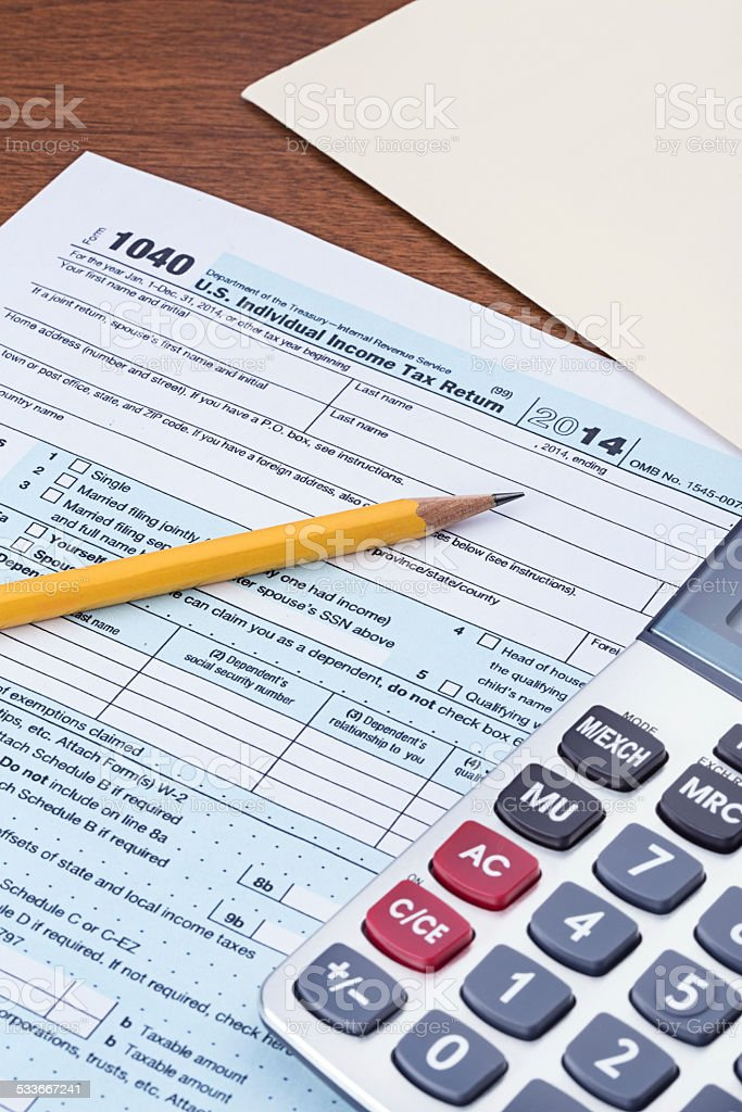 2014 Tax Form 1040 Stock Photo - Download Image Now - iStock