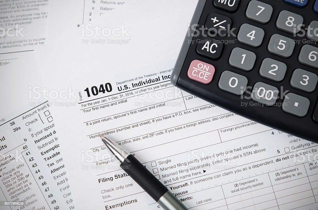 US tax form 1040 with pen and calculator stock photo