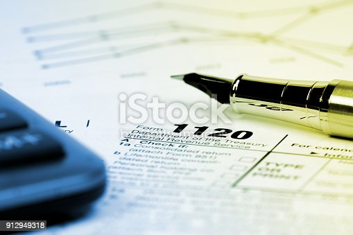 istock tax form 1120 with calculator, monochrome image 912949318