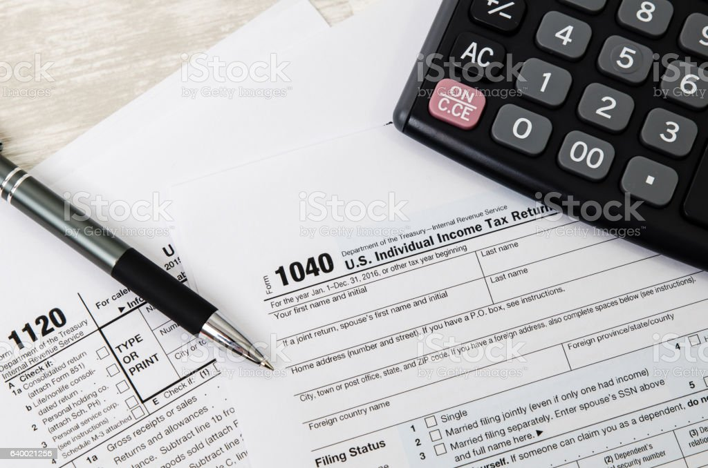 US tax form 1120 with pen and calculator stock photo