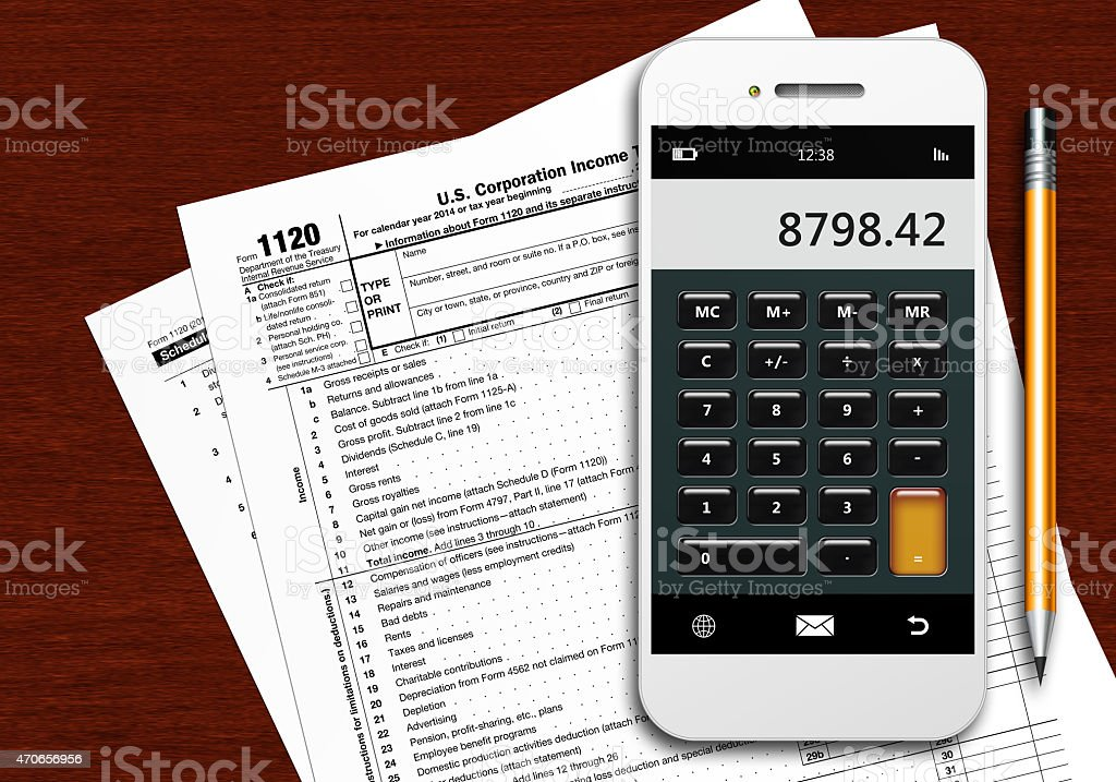 Tax Form 1120 With Phone Calculator And Pencil Stock Photo