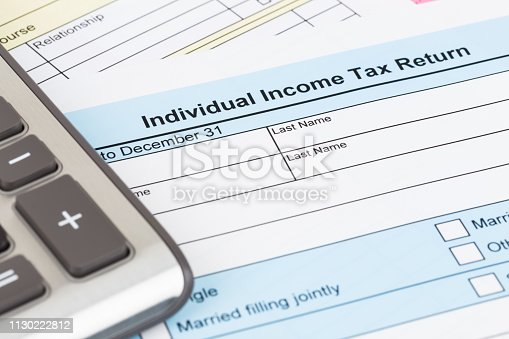 1145921132istockphoto Tax form and calculator; document are mock-up 1130222812
