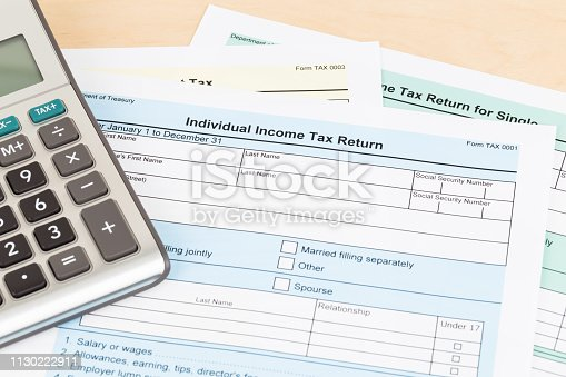 1145921132istockphoto Tax form and calculator; document are mock-up 1130222911