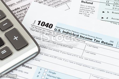 istock Tax form and calculator 1130222756