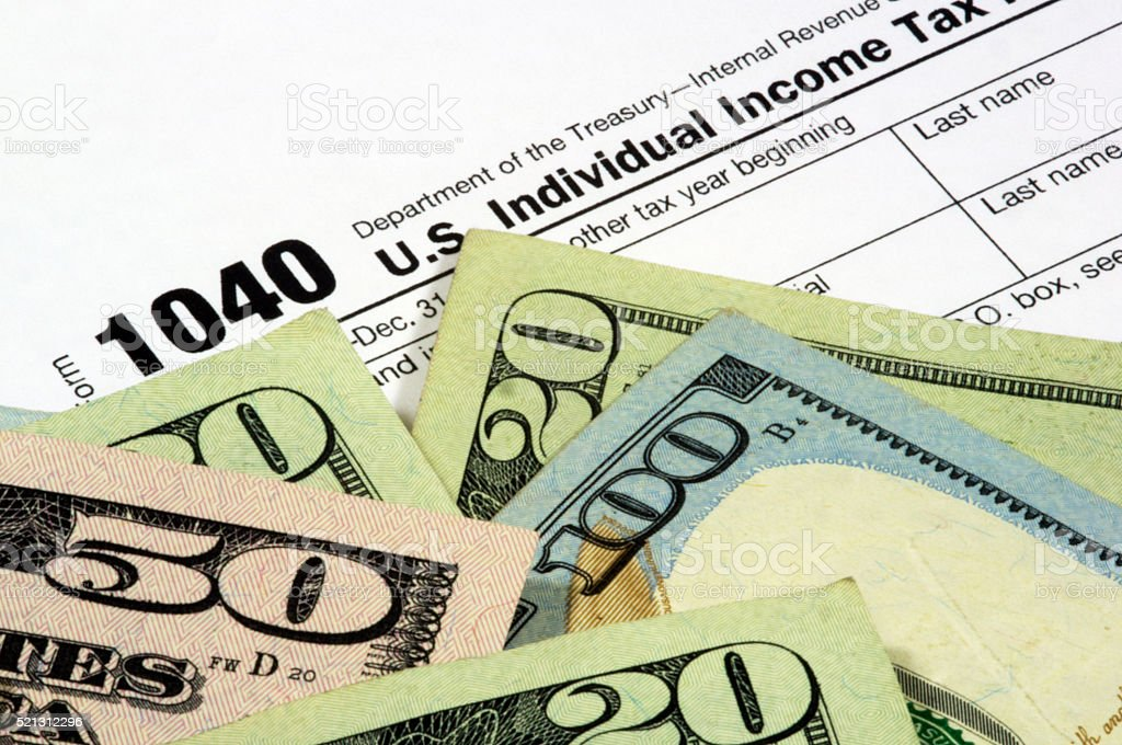 Tax Form and Currency stock photo