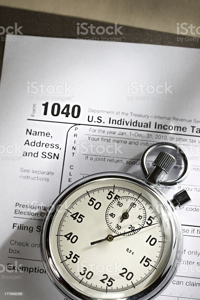 Tax form and stopwatch royalty-free stock photo