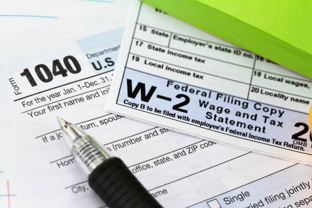 IRS 1040 tax form and w-2 wage statement: tax preparation concept. stock photo
