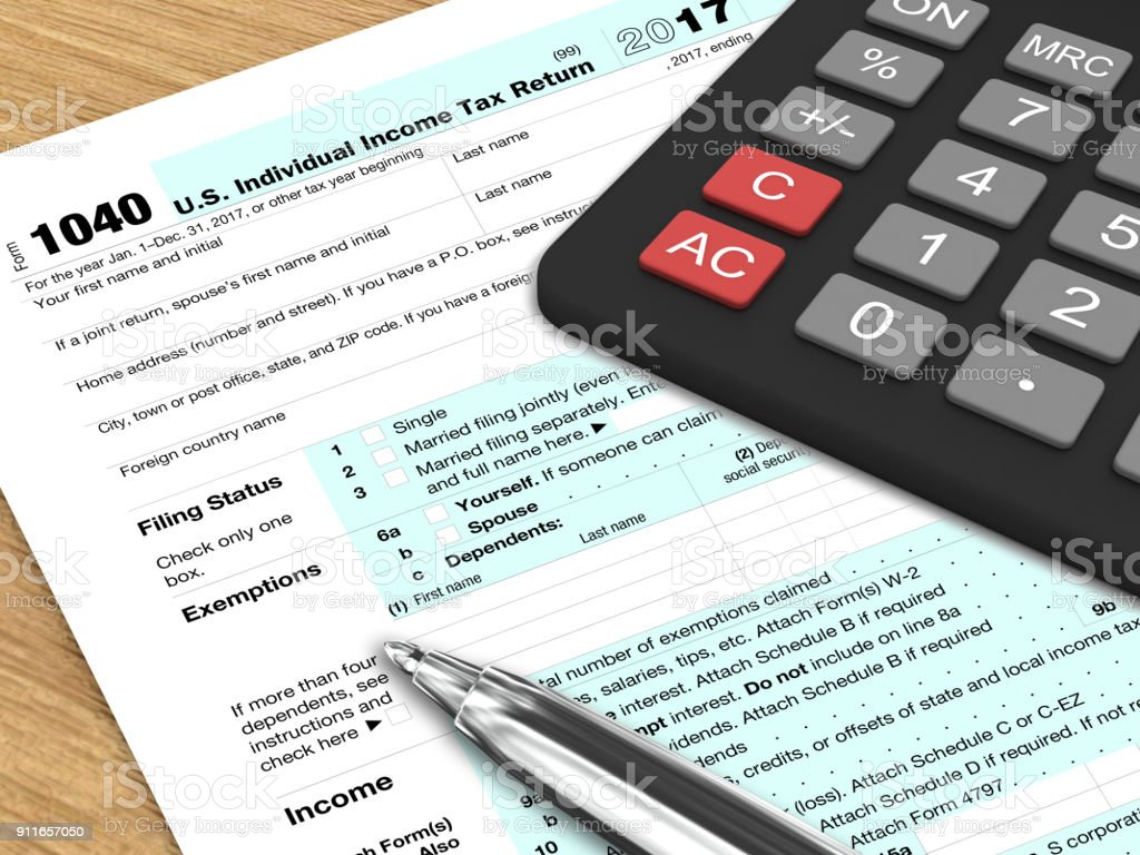 tax form calculator refund payment wooden desk table stock photo