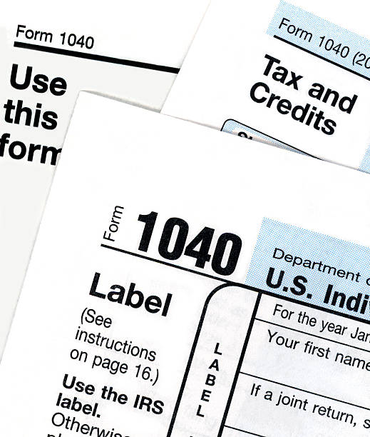 Tax Form Close-up A close-up of IRS tax forms. 1040 tax form stock pictures, royalty-free photos & images