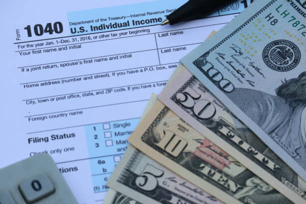 US tax form, dollar cash, finance accounting tax season concept stock photo