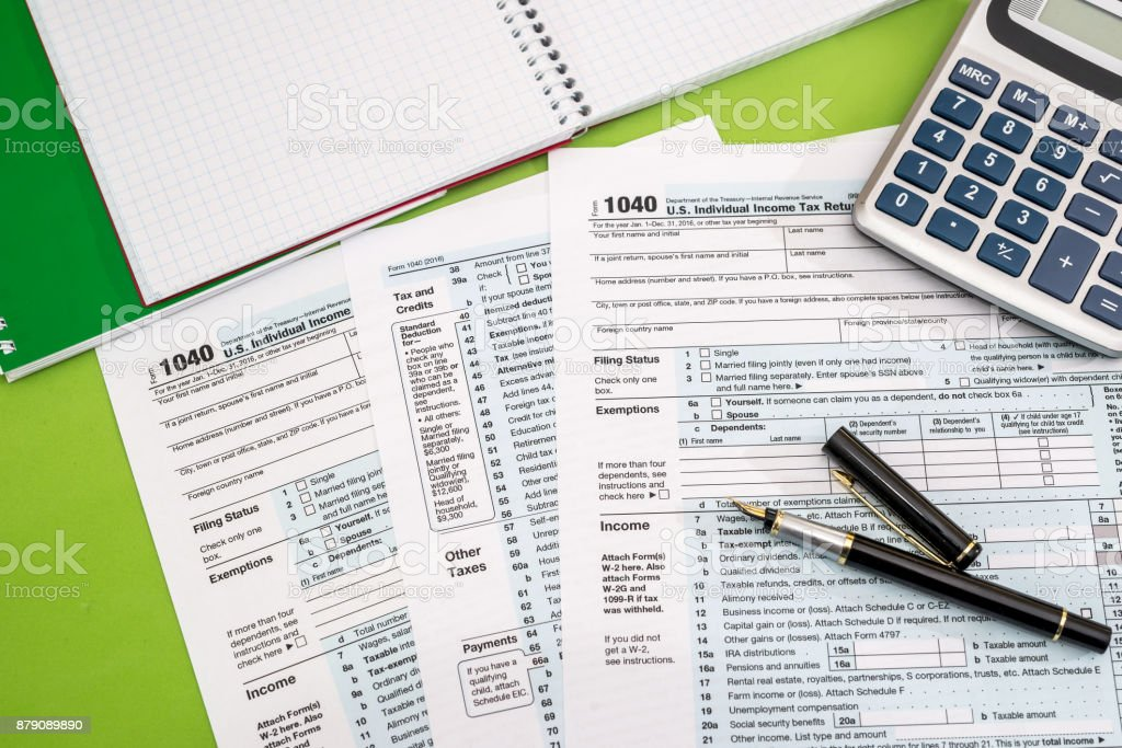 tax form, pen, note and calculator stock photo