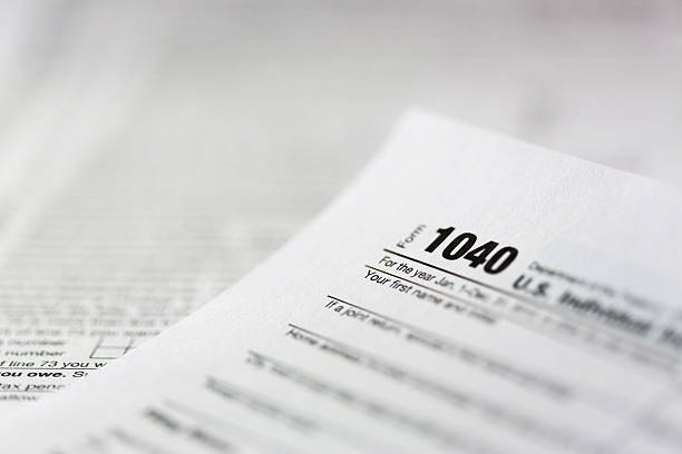 tax form 1040 tax form 1040 tax form stock pictures, royalty-free photos & images