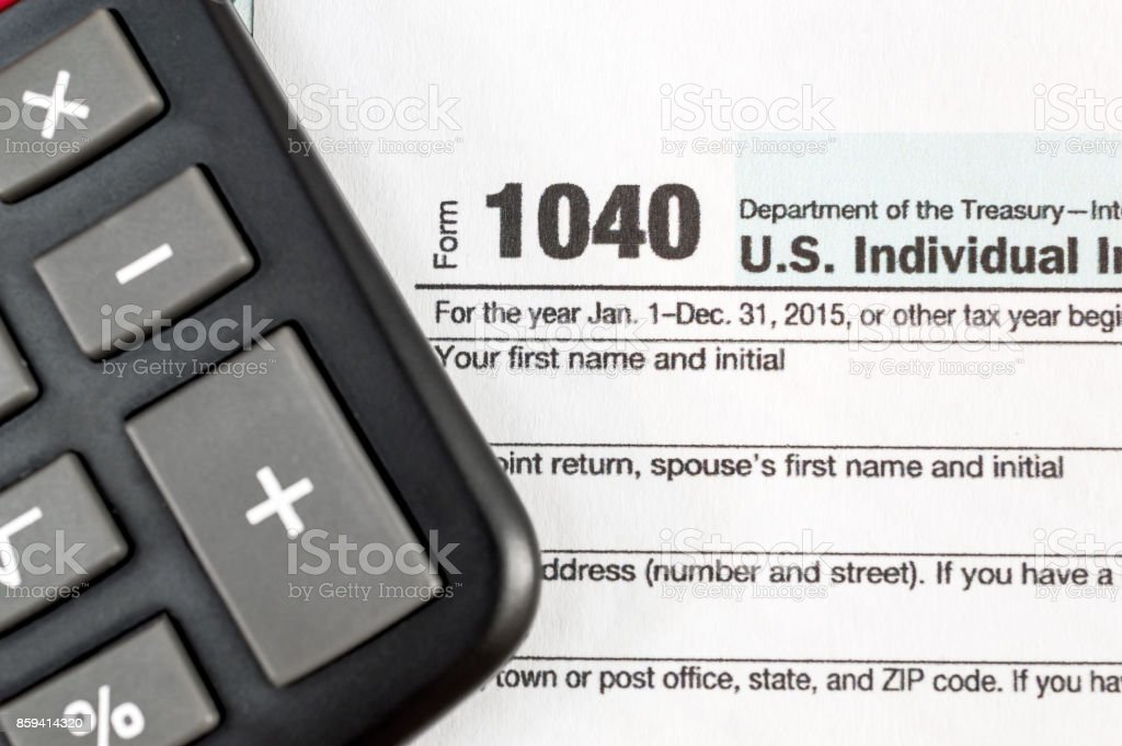 Tax form with calculator. Close up. stock photo