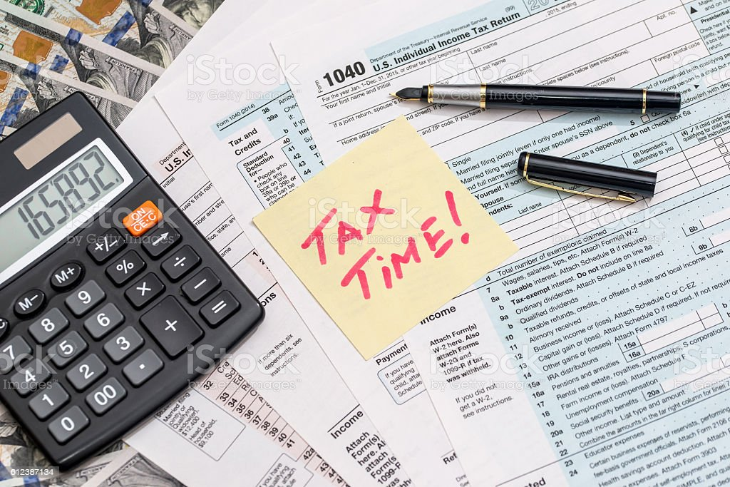 tax-form-with-calculator-money-and-pen-picture-id612387134  Form Example on complete new, adjusted gross income, standard deduction, tax transcript, filling out form, joint tax return, completed for teenager, self-employment tax, jointl tax return,