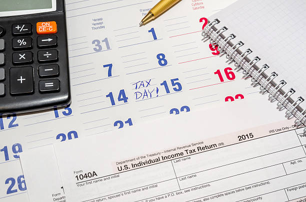 Royalty Free Calendar With Tax Due Date And Us Money Pen Calculator