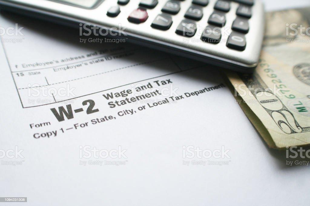 w2 form calculator  W14 Tax Form With Calculator Twenty Dollar Bill Stock Photo ...