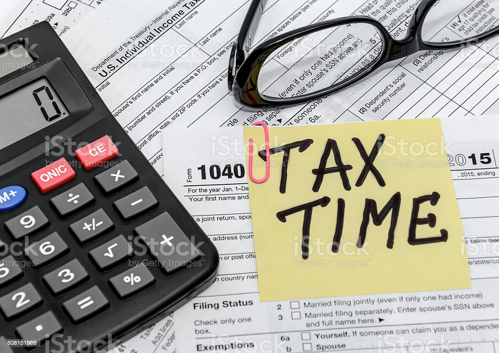 tax form with callculator and glasses stock photo