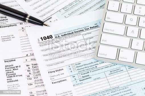 istock Tax form with keyboard, and pen 1096948768