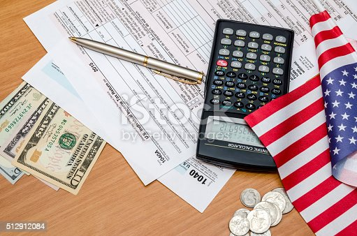 istock Tax form with money, pen and calculator, flag 512912084