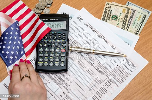 istock Tax form with money, pen and calculator, flag 514270838