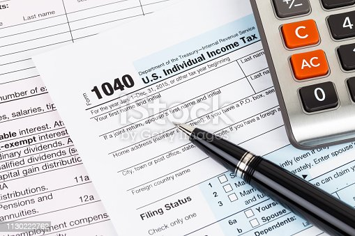 istock Tax form with pen and calculator 1130222762